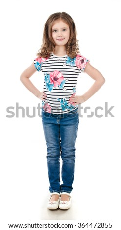 Cute smiling little girl in jeans isolated on a white - stock photo