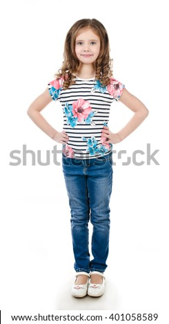 Cute smiling little girl in jeans isolated on a white