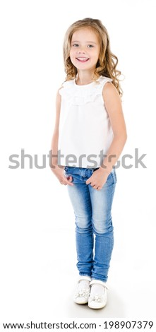 Cute smiling little girl in jeans isolated on white - stock photo