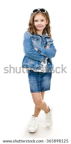 Cute smiling little girl in skirt with sunglasses isolated on a white