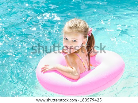 Cute smiling little girl in swimming pool  - stock photo