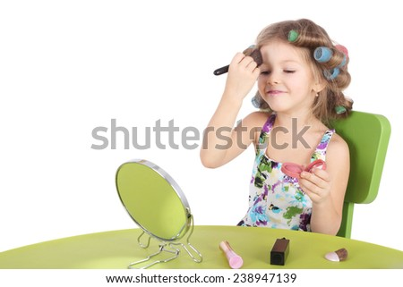cute smiling little girl making makeup - stock photo