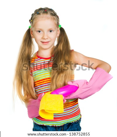 Cute smiling little girl with detergents on white background - stock photo