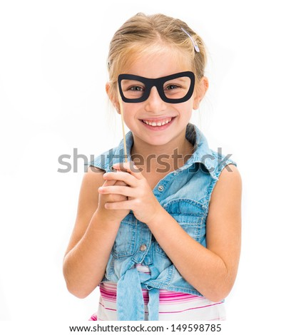 cute smiling little girl with fake glasses - stock photo