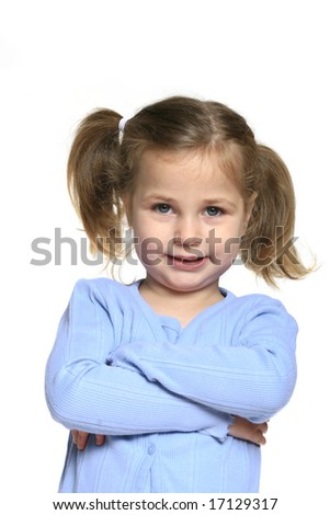 Cute, smiling little girl with pig tails and arms crossed isolated on white - stock photo