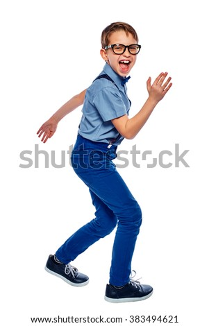 Cute smiling screaming dancing little boy in glasses. He is laughing and enjoy it. Isolated on white background. - stock photo