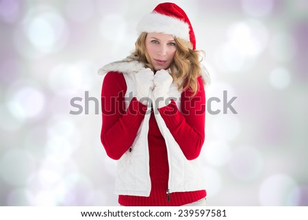 Cute smiling woman in stylish warm clothing against purple abstract light spot design
