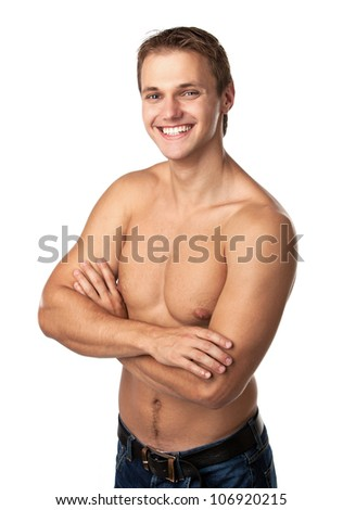 Cute smiling young guy in jeans with bare torso - stock photo