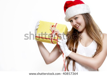 Cute Snow Maiden with a gift box - stock photo