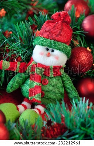 Cute snowman and Christmas tree . - stock photo