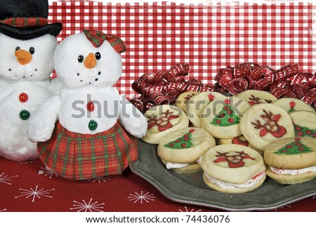 cute snowmen with christmas cookies