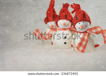Cute snowmen, with copy space and vintage texture applied - stock photo