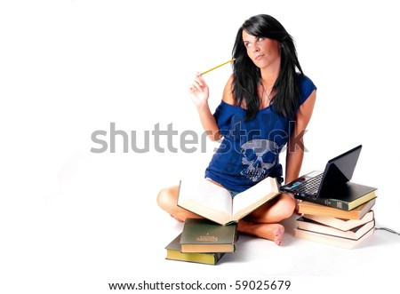 cute student girl do homework with books and laptop over white background