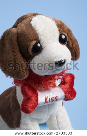 Cute stuffed dog with a kiss sign