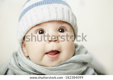 Cute surprised baby looking up - stock photo