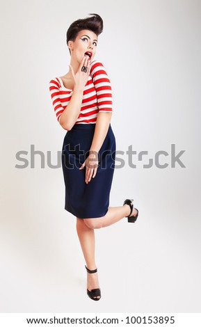 cute surprised woman in t-shirt and skirt - stock photo