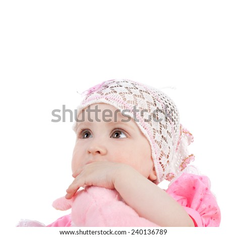 cute sweet little baby girl biting her toy - stock photo