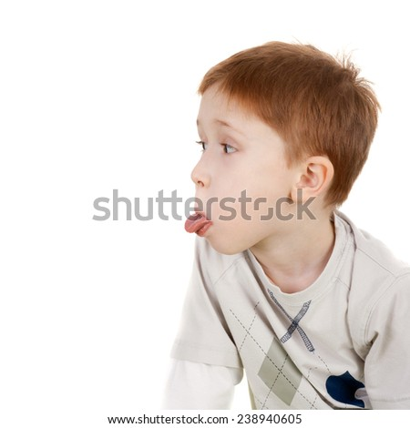 cute sweet little boy showing the tongue - stock photo