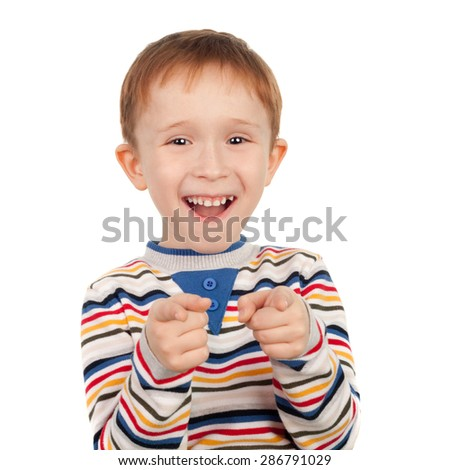 cute sweet smiling little boy pointing forward - stock photo