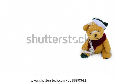 Cute teddy bear sits in the snow - isolated in white background for christmas or new year 2016