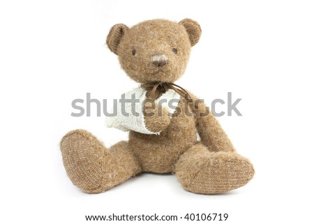 cute teddy bear with a broken arm in a sling - stock photo