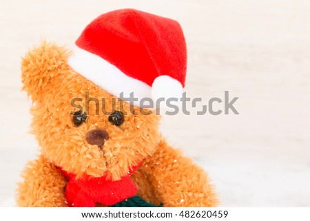 Cute teddy bear with red hat. Christmas atmosphere