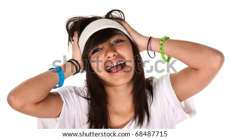 Cute teen-aged girl holds her head while screaming - stock photo