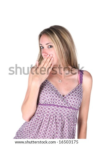cute teen covering her mouth with her hand - stock photo