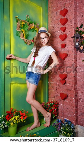 cute teen girl standing on the porch of a country house pots of flowers standing - Cute Teen Com