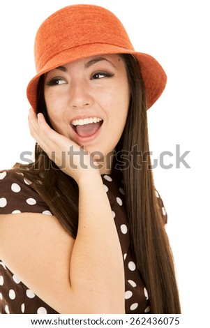 Cute teen girl wearing orange hat laughing - stock photo