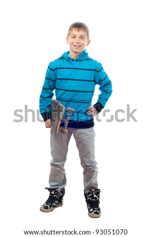 Cute teenage boy posing with skateboard in his hand isolated on white