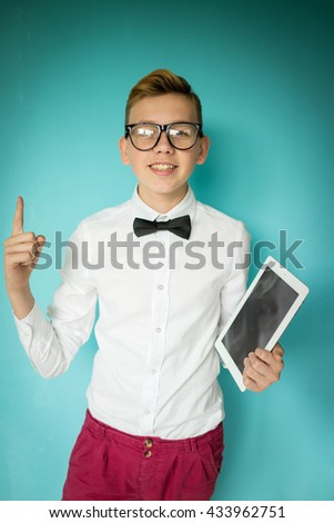 Cute teenage boy with a tablet