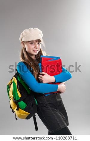 Cute teenage girl holding books - stock photo