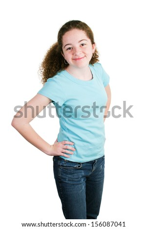 Cute teenage girl in blank blue t-shirt ready for text.