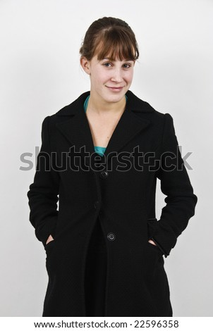 Cute teenage girl, standing against a white background in a studio. - stock photo