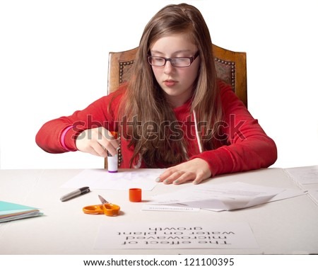 Cute teenage girl student working on school science fair project - stock photo