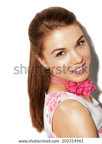 cute teenage girl wearing tunic and blue jeans standing