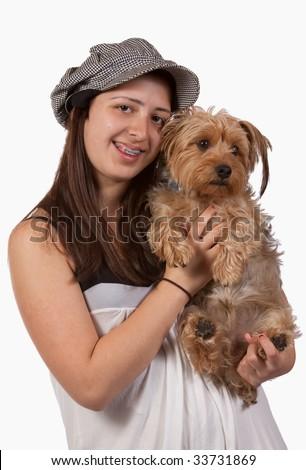 Cute teenage hispanic girl holding a pet yorkshire terrier dog - stock photo
