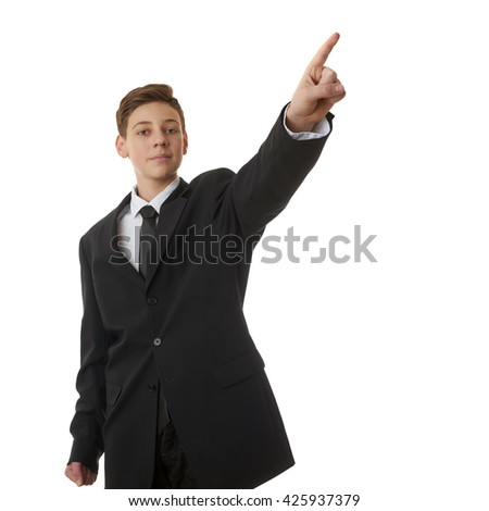 Cute teenager boy in back business suit opointing up side over white isolated background, half body, future career concept - stock photo