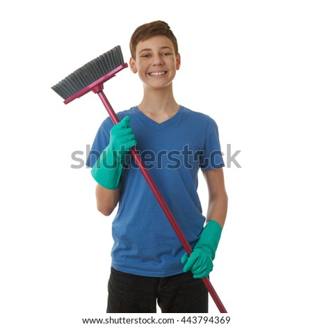 Cute teenager boy in blue T-shirt and green rubber gloves with broom over white isolated background, half body, cleaning concept - stock photo
