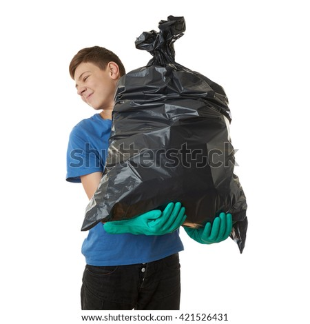 Cute teenager boy in blue T-shirt and green rubber gloves with garbage bag over white isolated background, half body, cleaning concept - stock photo