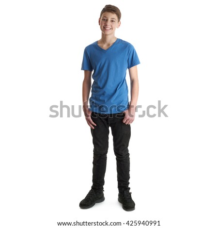 Cute teenager boy in blue T-shirt standing over white isolated background full body - stock photo