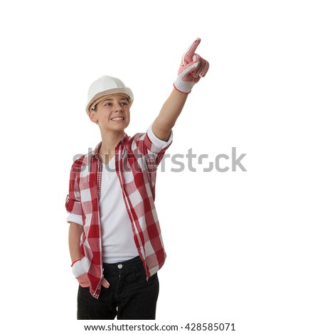 Cute teenager boy in red checkered shirt and building helmet pointing up side over white isolated background, half body, constructing concept - stock photo