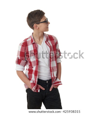 Cute teenager boy in red checkered shirt and glasses looking side over white isolated background, half body - stock photo