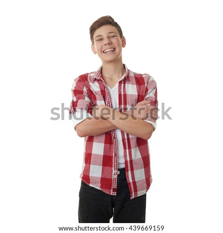 Cute teenager boy in red checkered with crossed arms shirt over white isolated background, half body - stock photo