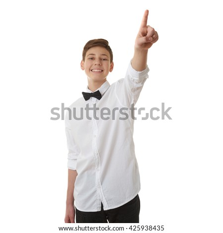 Cute teenager boy in white shirt and black bow tie pointing up side over white isolated background, half body - stock photo