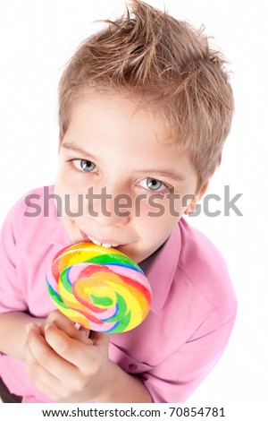 Cute teenager eating a lollipop - stock photo