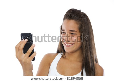 Cute teenager smiling with a mobile phone isolated on white