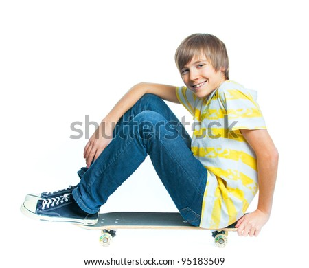cute teenger blond boy on sitting on skateboard isolated on white background