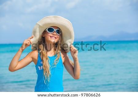 Cute teens girl in big hat relax ocean background - stock photo